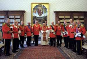 Pope Benedict XVI poses with the new Grand Master of the Knights of Malta, Matthew Festing (centre L) of Britain, and his entourage during their meeting at the Vatican June 23, 2008. Festing was elected in March as the new Grand Master of the Knights of Malta, which began as a Christian crusading military order more than 900 years ago and now operates as a worldwide charity. Elected in a secret conclave, he succeeds Andrew Willoughby Ninian Berti, also British, who died in February 2008. REUTERS/Osservatore Romano (VATICAN)